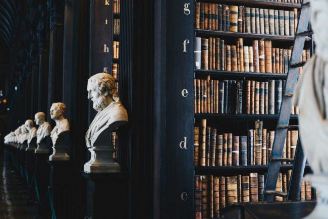 book lot on black wooden shelf